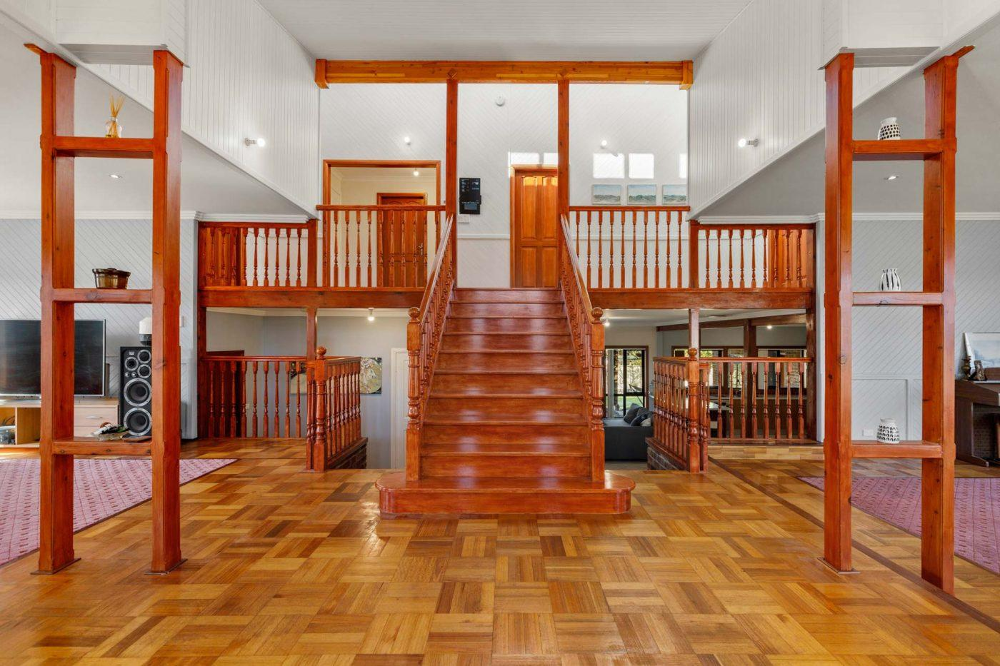 Rustic Welcoming Area with Wooden Floors & Stairwell