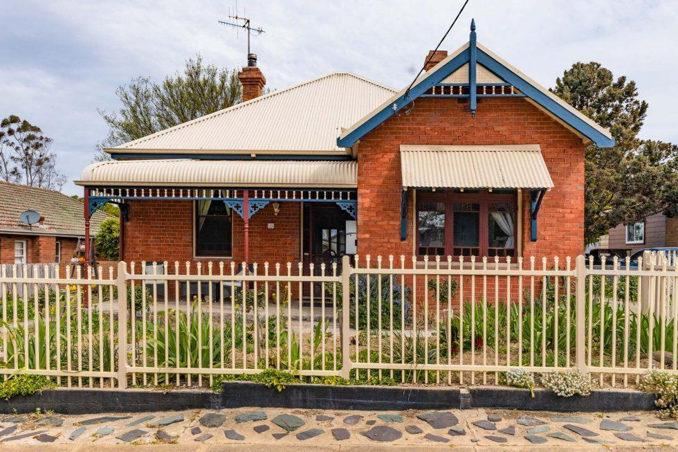 Cosy Brick Home with Picket Fence